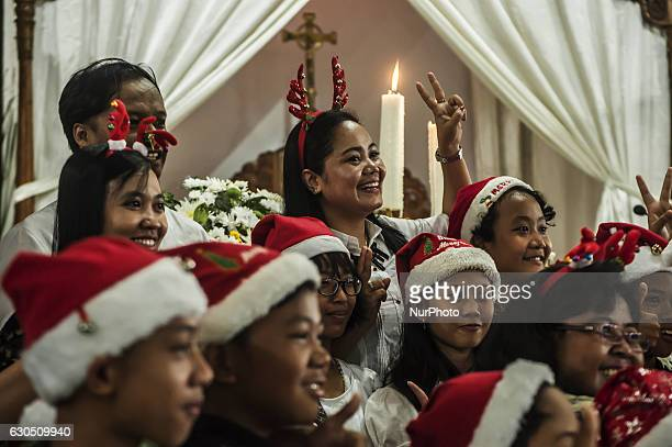 Christian people take photo together when attend mass in celebration of Christmas in Sacred Heart of Jesus Catholic Church in Yogyakarta Indonesia on...