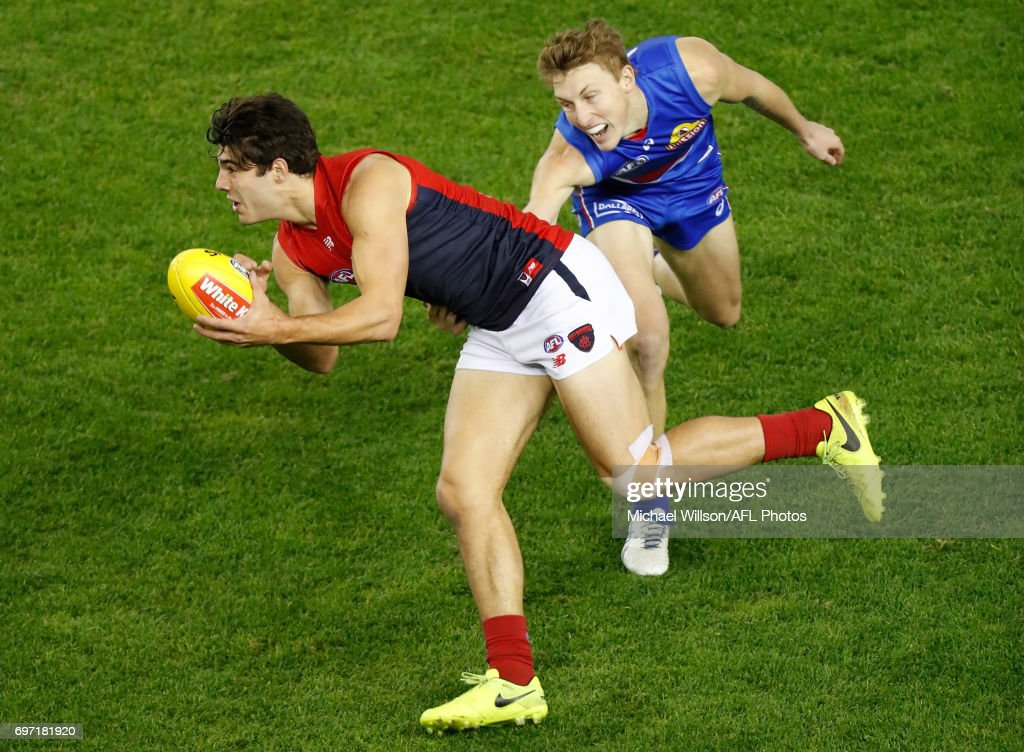 Christian Petracca of the Demons and Bailey Dale of the Bulldogs in action during the 2017 AFL round 13 match between the Western Bulldogs and the Melbourne Demons at Etihad Stadium on June 18, 2017 in Melbourne, Australia.