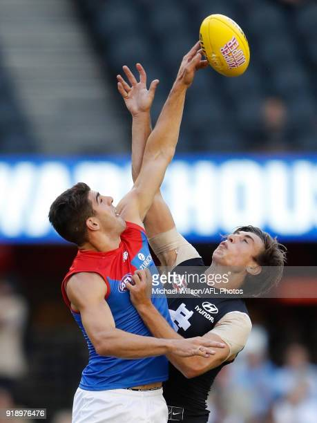 Christian Petracca of the Demons and Caleb Marchbank of the Blues compete in a ruck contest during the AFLX match between the Melbourne Demons and...
