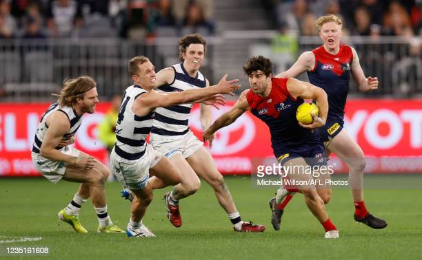 Christian Petracca of the Demons and Joel Selwood of the Cats in action during the 2021 AFL First Preliminary Final match between the Melbourne...