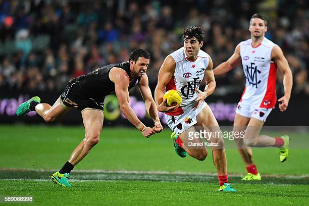 Christian Petracca of the Demons evades a tackle from Travis Boak of the Power during the round 21 AFL match between the Port Adelaide Power and the...