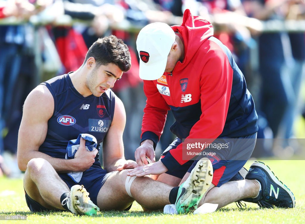 Christian Petracca of the Demons gets his knees strapped during a Melbourne Demons AFL training session at Gosch's Paddock on September 11, 2018 in Melbourne, Australia.