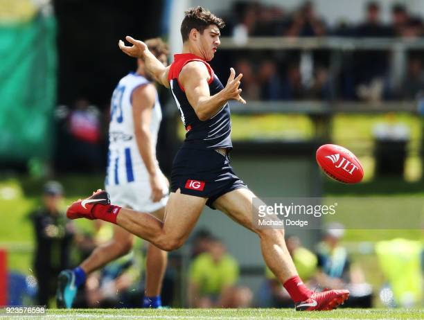 Christian Petracca of the Demons kicks a long torpedo during the JLT Community Series AFL match between the North Melbourne Kangaroos and the...