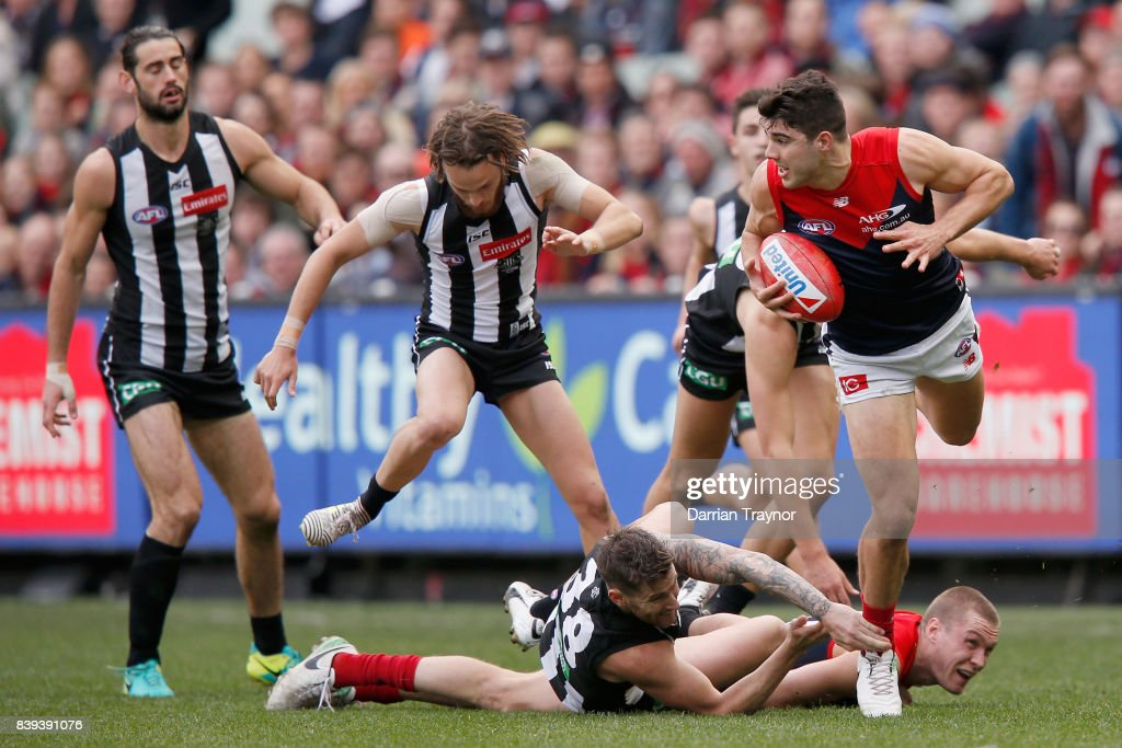 Christian Petracca of the Demons leaps over team mate during the round 23 AFL match between the Collingwood Magpies and the Melbourne Demons at Melbourne Cricket Ground on August 26, 2017 in Melbourne, Australia.