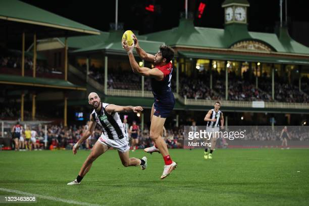 Christian Petracca of the Demons takes a mark during the round 13 AFL match between the Melbourne Demons and the Collingwood Magpies at Sydney...