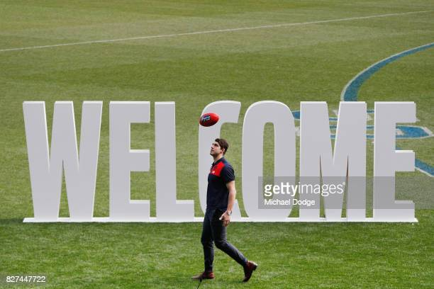 Christian Petracca plays with a football during the Melbourne Demons AFL Welcome Game Launch media opportunity at Melbourne Cricket Ground on August...