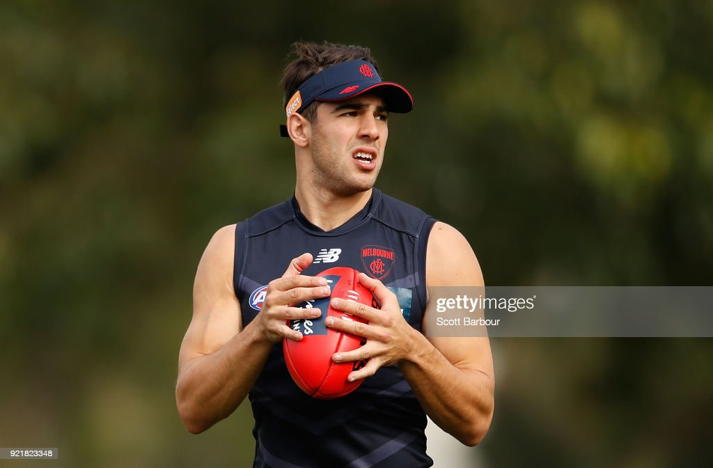 Christian Petracca runs with the ball during a Melbourne Demons AFL training session at Gosch's Paddock on February 21, 2018 in Melbourne, Australia.