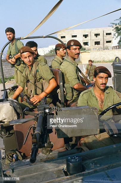Christian Phalangist militia forces with a military truck in East Beirut as they prepare to move heavy equipment and artillery into the mountains...