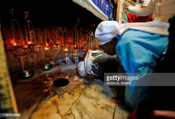 Christian pilgrim kisses the 14 pointed silver star, believed to be the exact spot where Jesus Christ was born, in the Grotto of the Church of the...