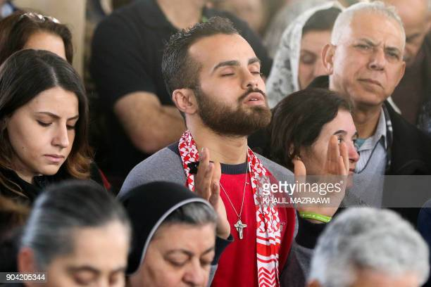 Christian pilgrims celebrate a mass during an annual pilgrimage in Bethany beyond the Jordan river the site where many believe Jesus Christ was...