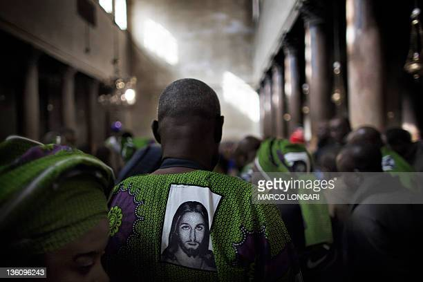Christian pilgrims from Nigeria visit the Church of the Nativity in the West Bank city of Bethlehem on December 24 2011 Christians began flocking to...