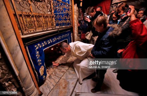 Christian pilgrims gather inside the Grotto believed to be the exact spot where Jesus Christ was born at the Church of the Nativity in the biblical...