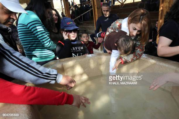 Christian pilgrims take part in an annual pilgrimage in Bethany beyond the Jordan river the site where many believe Jesus Christ was baptised west of...