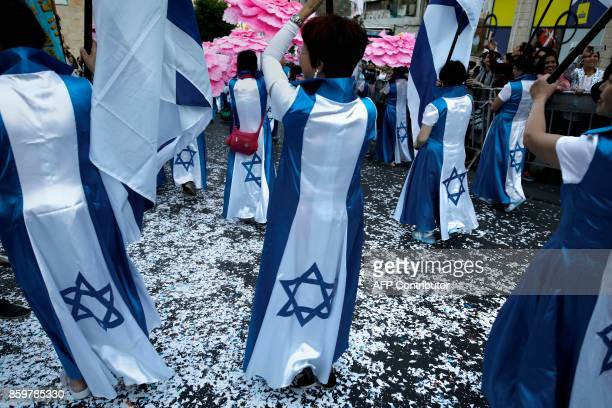 TOPSHOT Christian pilgrims take part in the annual support march for Israel in Jerusalem on the occasion of the Sukkot holiday organised by the...