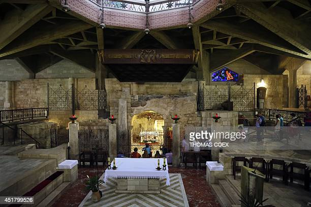 Christian pilgrims visit the grotto of the Catholic Church of the Annunciation believed to stand at the site of Mary's house where angel Gabriel...