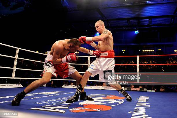 Christian Pohl exchanges punches with Dariusz Sek during their super middleweight fight during the Universum Champions night at the Alsterdorfer...