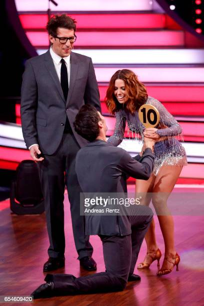 Christian Polanc hands over the 10 point sign to her dance partner Vanessa Mai next to Host Daniel Hartwich on stage during the 1st show of the tenth...