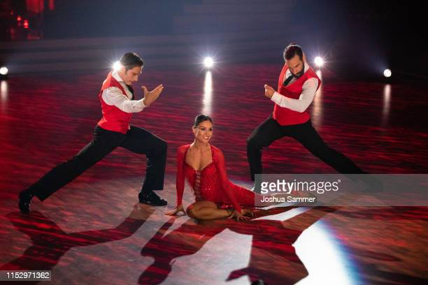 "Christian Polanc, Nazan Eckes and Massimo Sinato perform on stage during the 10th show of the 12th season of the television competition ""Let's Dance""..."
