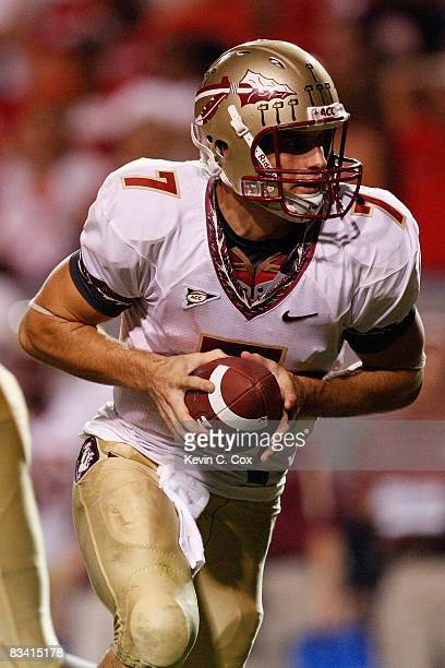 Christian Ponder of the Florida State Seminoles looks to hand off during the game against the North Carolina State Wolfpack at CarterFinley Stadium...