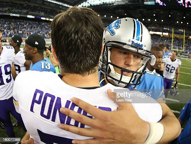 Christian Ponder of the Minnesota Vikings and Matthew Stafford of the Detroit Lions meet after the game at Ford Field on September 8 2013 in Detroit...