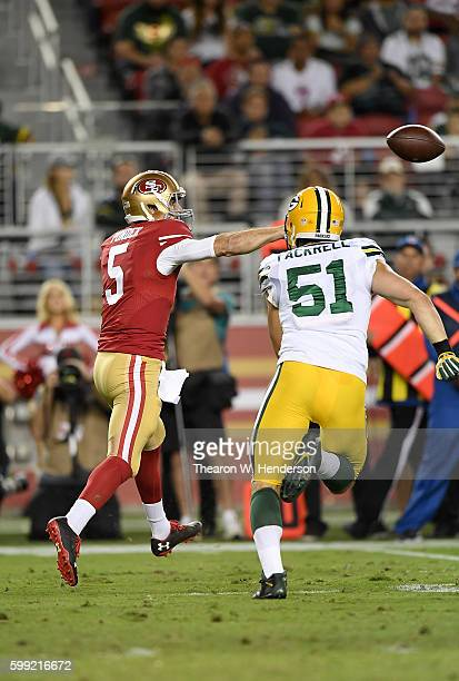 Christian Ponder of the San Francisco 49ers gets his pass off under pressure from outside linebacker Kyler Fackrell of the Green Bay Packers in the...