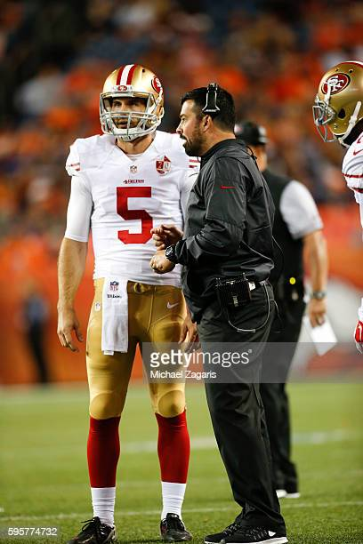 Christian Ponder of the San Francisco 49ers talks with Quarterbacks Coach Ryan Day during the game against the Denver Broncos at Sports Authority...