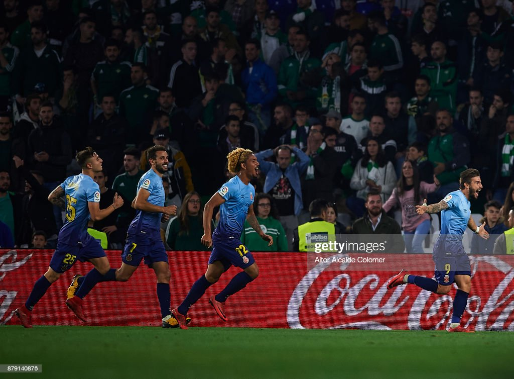 Christian Portu of Girona CF celebrates after scoring the second goal for Girona CF during the La Liga match between Real Betis and Girona at Estadio Benito Villamarin on November 25, 2017 in Seville, .
