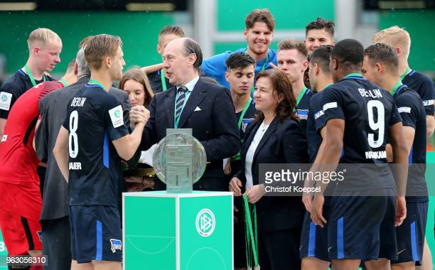 Christian Pothe chairman of the youth committee of the German Football Association hands out the gold medal to Arne Maier of Berlin after winning 31...