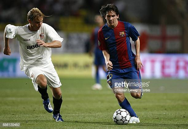 Christian Poulsen and Lionel Messi during the 2006 UEFA Super Cup match between FC Barcelona and Sevilla FC