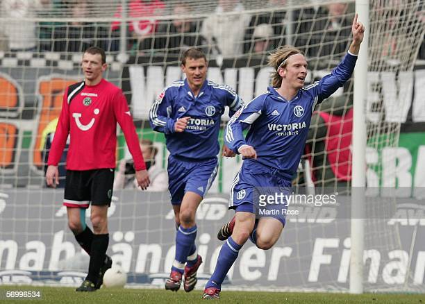 Christian Poulsen celebrates scoring the 1st goal during the Bundesliga match between Hanover 96 and FC Schalke 04 at the AWD Arena on March 4 2006...