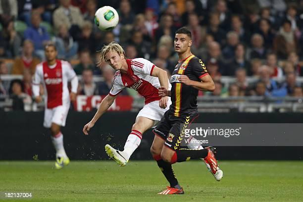 Christian Poulsen of Ajax Deniz Turuc of Go Ahead Eagles during the Dutch Eredivisie match between Ajax Amsterdam and Go Ahead Eagles on September 28...