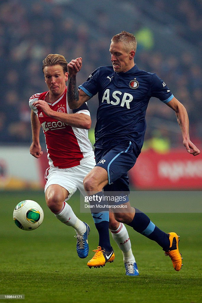 Christian Poulsen (#5) of Ajax is beaten by Lex Immers of Feyenoord during the Eredivisie match between Ajax Amsterdam and Feyenoord Rotterdam at Amsterdam Arena on January 20, 2013 in Amsterdam, Netherlands.