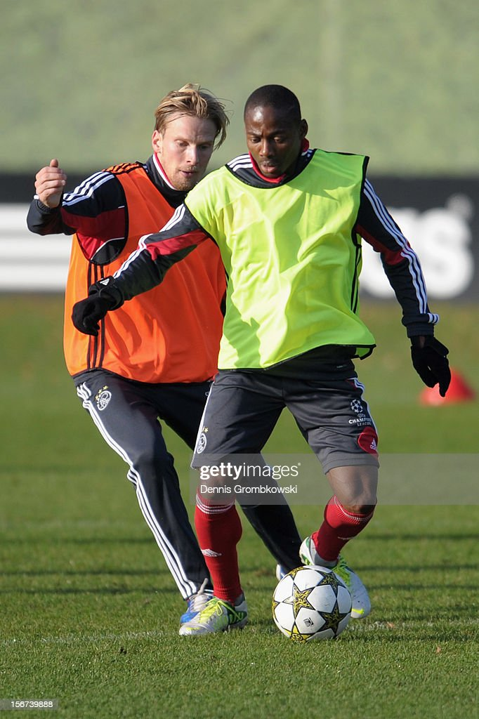 Christian Poulsen of Amsterdam and teammate Stefano Denswil battle for the ball during a training session ahead of the UEFA Champions League match against Borussia Dortmund on November 20, 2012 in Amsterdam, Netherlands.