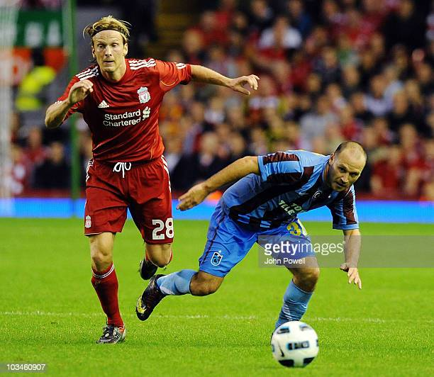Christian Poulsen of Liverpool tussles with Serkan Balci of Trabzonspor AS during the UEFA Europa League Play off first leg Qualifying match between...
