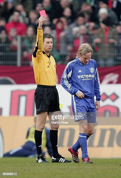 Christian Poulsen of Schalke receives the red card during the Bundesliga match between Hanover 96 and FC Schalke 04 at the AWD Arena on March 4 2006...