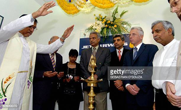 Christian priest showers blessings on Chairman of Jet Airways Naresh Goyal Airlines CEO Wolfgang ProckSchaur and other members before leaving on the...