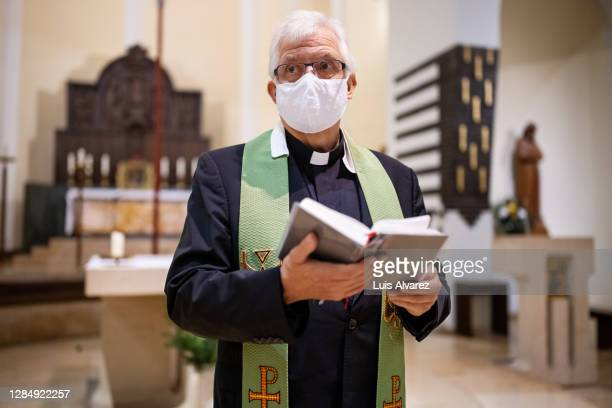 christian priest standing by the altar - 司祭 ストックフォトと画像