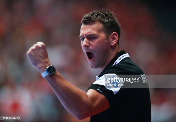 Christian Prokop head coach of Germany celebrates during the Men's EHF EURO 2020 main round group I match between Austria and Germany at Wiener...