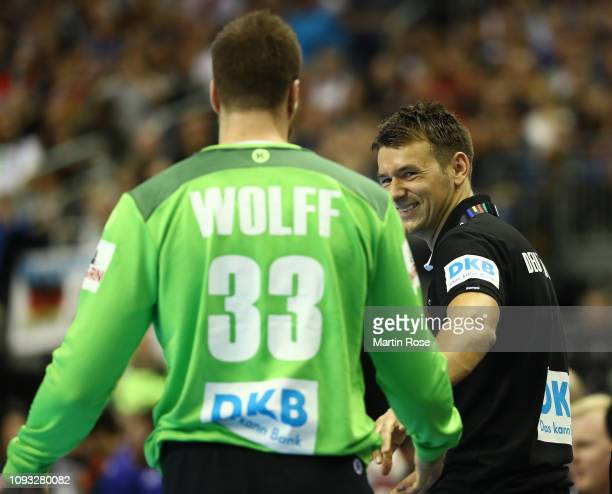 Christian Prokop head coach of Germany smiles at Andreas Wolff during the 26th IHF Men's World Championship group A match between Germany and Brazil...