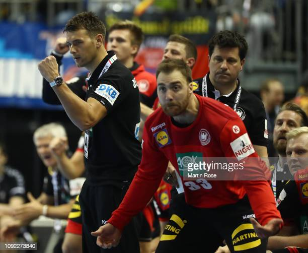 Christian Prokop head coach of of Germany celebrates with Andreas Wolff during the 26th IHF Men's World Championship group A match between Korea and...