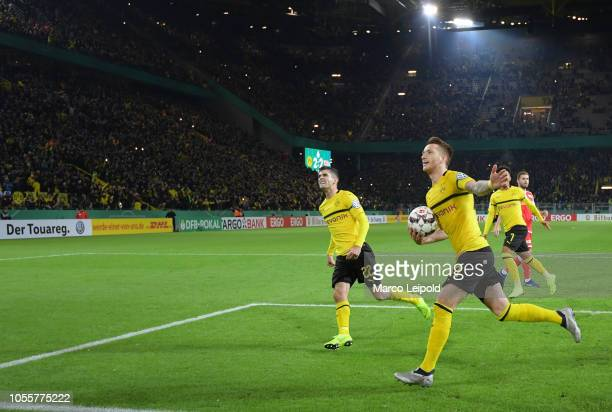 Christian Pulisic and Marco Reus of Borussia Dortmund celebrate after scoring the 32 during the game between Borussia Dortmund and Union Berlin at...