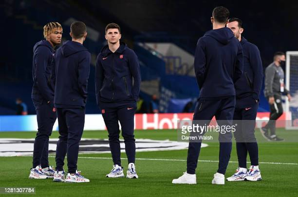 Christian Pulisic Ben Chilwell Kai Havertz and Reece James of Chelsea talk during a pitch inspection prior to the UEFA Champions League Group E stage...