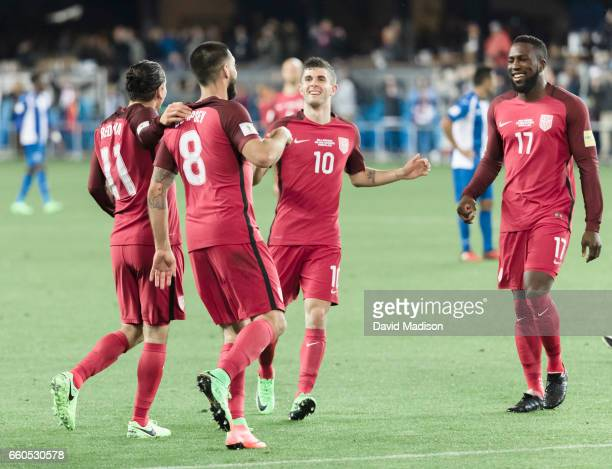 Christian Pulisic Jozy Altidore and Alejandro Bedoya congratulate Clint Dempsey of the United States after Dempsey scored his third goal of the FIFA...