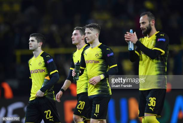 Christian Pulisic Maximilian Philipp Marco Reus and Omer Toprak of Borussia Dortmund look dejected in defeat after the UEFA Europa League Round of 16...