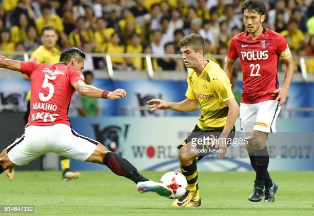 Christian Pulisic of Borussia Dortmund and Tomoaki Makino of Urawa Reds vie for the ball during the first half of an international friendly at...