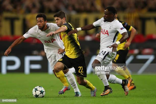Christian Pulisic of Borussia Dortmund attempts to get away from Mousa Dembele of Tottenham Hotspur and Serge Aurier of Tottenham Hotspur during the...