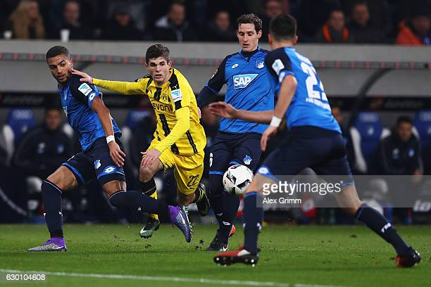 Christian Pulisic of Borussia Dortmund battles for the ball with Kerem Demirbay Sebastian Rudy and Benjamin Hubner of TSG 1899 Hoffenheim during the...