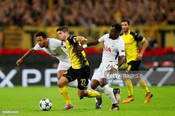 Christian Pulisic of Borussia Dortmund battles for the ball with Mousa Dembele and Serge Aurier of Tottenham Hotspur during the UEFA Champions League...