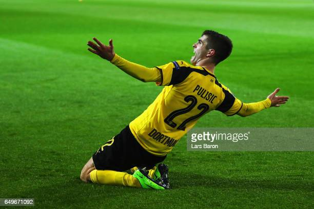 Christian Pulisic of Borussia Dortmund celebrates after he shoots and scores his teams second goal during the UEFA Champions League Round of 16...