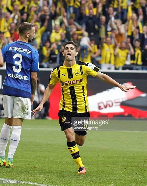 Christian Pulisic of Borussia Dortmund celebrates after scoring a goal during Bundesliga soccer match between Borussia Dortmund and SV Darmstadt 98...